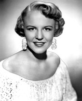 Black-and-white image of Peggy Lee.