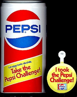 """Pepsi Challenge - An early 1980s """"Pepsi Challenge"""" 12 oz. (355 ml.) promotional can, and a metal tab button publicizing the challenge."""