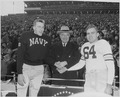 Photograph of President Truman shaking hands with the captains of the Army and Navy teams before their annual... - NARA - 200398.tif