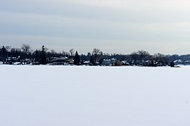 Houses along Pine Lake in the winter