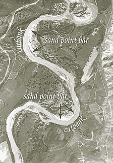 Point bar A depositional feature of alluvium that accumulates on the inside bend of streams and rivers below the slip-off slope
