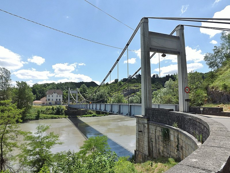 Sight of the suspension bridge of Yenne crossing the river Rhône and seen from Nattages in Ain, in the direction of Yenne in Savoie, France.