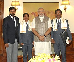Poorna Malavath and Anand Kumar, teenaged mountaineers who recently scaled Mt. Everest, calling on the Prime Minister, Shri Narendra Modi, in New Delhi on June 06, 2014. Their coach, Shri Shekhar Babu is also seen (1).jpg