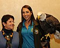 Posing for picture with Bald Eagle. (10595551776).jpg