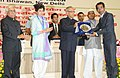 Pranab Mukherjee presenting the National Award for outstanding Services in the field of Prevention of Alcoholism and Substance (Drug) Abuse-2013 to Dr. Anil Awachat, Secretary, Muktangan Mitra, a de-addiction centre at Pune (1).jpg