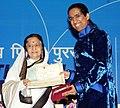 Pratibha Devisingh Patil presenting the Rajat Kamal Award to Prof. Arindam Chaudhuri for the Best Hindi Film (Hindi Do Dooni Char), at the 58th National Film Awards function, in New Delhi on September 09, 2011.jpg