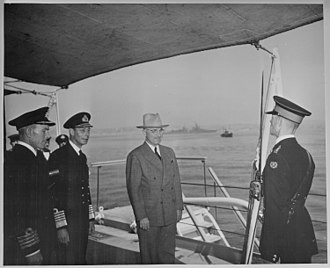 HMS Renown (1916) - President Harry S. Truman and King George VI on the quarterdeck of HMS Renown where the President had lunch with the King. Truman is preparing to leave England on the Augusta, visible in the background, after attending the Potsdam Conference in Germany.