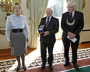 Michael D. Higgins - President Higgins received the Order of Clans of Ireland in April 2012. Also pictured are Sabina Coyne (left) and Dr. Michael J. Egan, Chairman of Clans of Ireland (right).