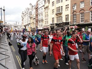 Homosexuality in modern sports - Gay football and rugby players marching in Pride London 2011.