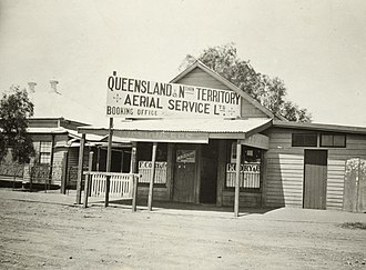 Qantas - Sign on a building in Longreach in Queensland, announcing that Queensland and Northern Territory Aerial Services (Q.A.N.T.A.S.) tickets could be booked within, c. 1921