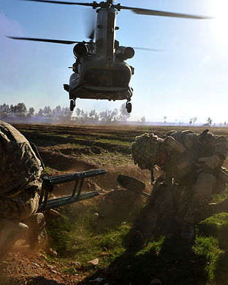 40 Commando - A Chinook flies in low over the heads of Royal Marines from Alpha Company, 40 Commando Royal Marines during Op DAAS 7B, Nahr-e-Saraj district, Afghanistan.
