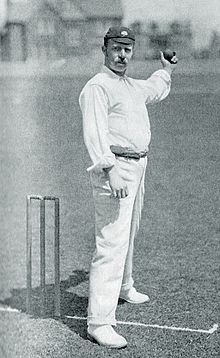 A cricketer posed about to bowl the ball
