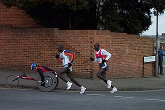 Reading Half Marathon - In 2005, Julius Kimutai chases down Malack Olemengera and a wheelchair athlete.