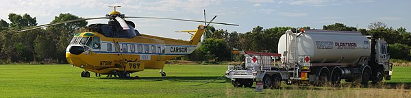 Refueling a fire fighting helicopter Southern River, Western Australia.