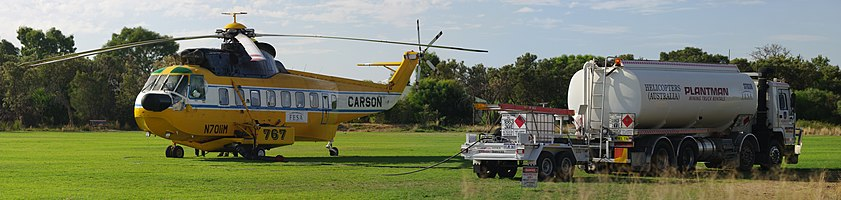 Refueling a Fire King Helitanker during firefighting operations in Southern River Western Australia