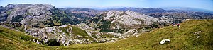 Cantabria - Panorama of the Cantabrian Mountains to the left and the port city of Santander in the distant right. The peak Alto de Brenas in Riotuerto has a height of 579 metres.