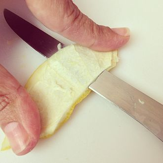 Zest (ingredient) - Slicing mesocarp from flavedo to make marmalade, using a flexible filet-style knife.
