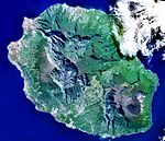 An overhead view of an island filled with high-altitude peaks.