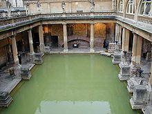 Roman public baths in Bath, England. The loss of the original roof has encouraged green algae growth.