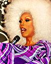 Drag queen RuPaul speaking into a microphone