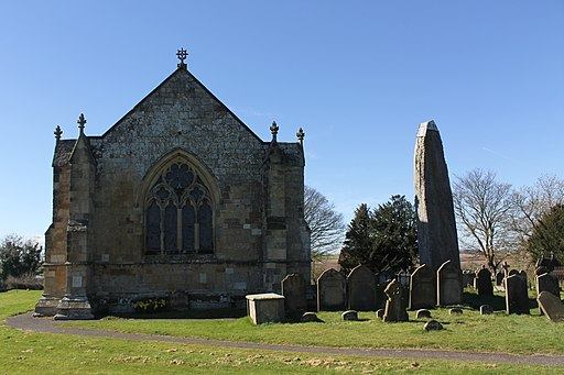 Rudston monolith and All Saints Parish Church, in the East Riding of Yorkshire