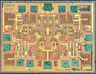 555 timer IC - Die of a NE556 dual timer manufactured by STMicroelectronics.