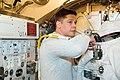 STS-123 Behnken EMU fit check.jpg
