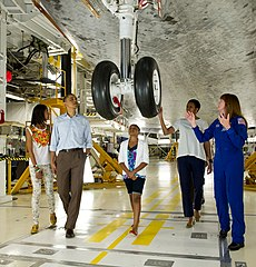 The Obama family being shown around Atlantis by Janet L. Kavandi on April 29, 2011. Image: NASA / Bill Ingalls.