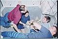 STS102-320-013 - STS-102 - Crewmember activity in the ISS MPLM - DPLA - c9135e0c20d1b82b8f8e11ff7a37a13e.jpg