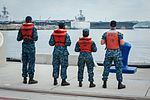 Sailors prepare to help moor USS John C. Stennis as it pulls into San Diego Bay. (28835735071).jpg