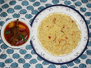 Aloo gosht - Saloonay chawal (brown rice) served with Aloo gosht.