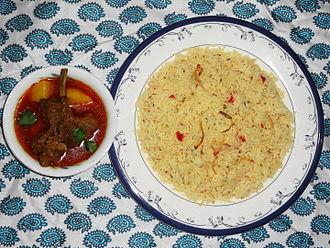 Aloo gosht - Saloonay chawal (brown rice) served with Aloo gosht.