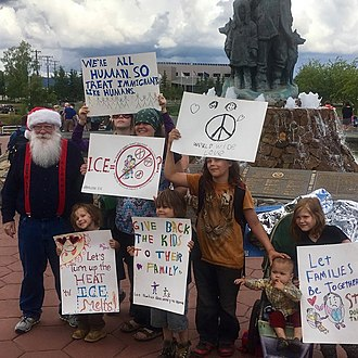 North Pole, Alaska - Santa Claus (his legal name, born Thomas O'Connor) has been a member of North Pole's city council since 2015.  He appears with a group of children who protested United States immigration policy in downtown Fairbanks in June 2018.