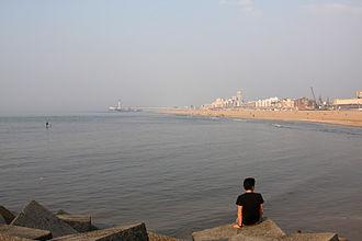 Scheveningen - Scheveningen pier in the background, view from the harbour's breakwater