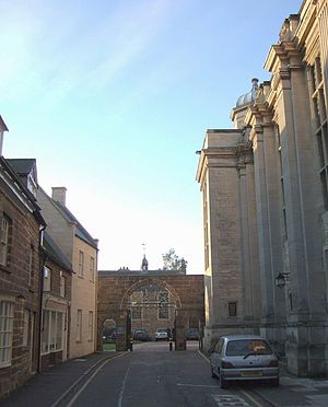 Uppingham School - School Lane; on the right is the Memorial Hall, built in the 1920s. The buildings on the left are now part of the school's Music Centre. The building beyond the arch is the Library, originally the hospital