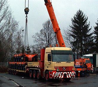Self-propelled modular transporter - SPMT being transported on low-loader