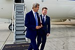 Secretary Kerry Walks With U.S. Ambassador to the United Kingdom Barzun After Landing in London (27836987742).jpg