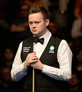Picture of Shaun Murphy standing by a snooker table