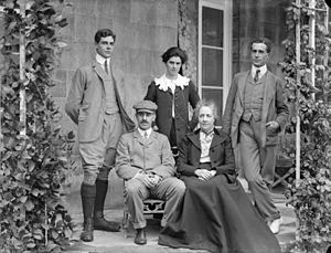 Sir John Keane, 5th Baronet - Sir John Keane, seated with hat, pictured with his family.