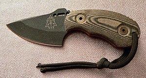 http://upload.wikimedia.org/wikipedia/commons/thumb/c/c3/Skinner_knife.jpg/300px-Skinner_knife.jpg