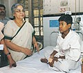 Smt. Gursharan Kaur, wife of the Prime Minister, Dr. Manmohan Singh, with a young boy who suffered injuries in recent bomb blasts at the Lokmanya Tilak Hospital, in Mumbai on July 14, 2006.jpg