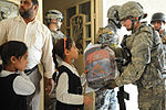 Soldiers, Iraqi national policemen distribute school supplies in Baghdad DVIDS157243.jpg