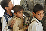 Soldiers, Iraqi national policemen distribute school supplies in Baghdad DVIDS157270.jpg