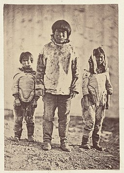 1869 photograph of Greenlandic Inuit. Some of the intelligent inhabitants, man, boy, and girl.jpg
