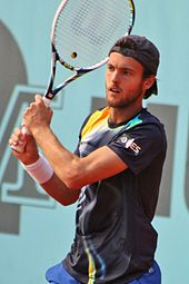 João Sousa hitting a two-handed backhand during a match