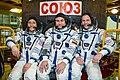 Soyuz MS-12 crew members in front of their spacecraft.jpg