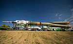 Soyuz TMA-04M spacecraft is rolled out by train.jpg
