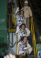 Soyuz TMA-10M crew members wave farewell.jpg