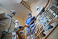 Staff members wearing protective suites captured at the staircase flight. Chernivtsi, Ukraine.jpg