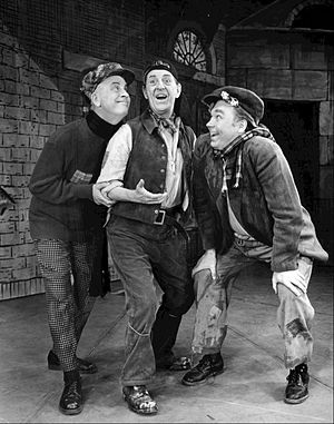 Holloway (centre) as Alfred P. Doolittle on Broadway in My Fair Lady, 1957 Stanley Holloway Alfred P. Doolittle My Fair Lady 1957.JPG